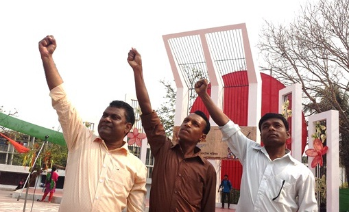 Dr. Hasan, Ukil Murmu and Mikhael Soren at Martyr Monument of 1952 Language Movement. Bangladesh.