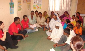 Photo 1- Listening to Micro Finance Groups and their Families