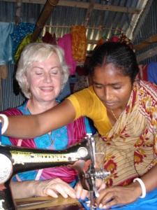 Photo 3- A Bangladesh Woman Entrepreneur sharing her skills with a Canadian Volunteer